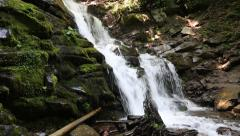 Beautiful waterfall. Water flows over the rocks Stock Footage