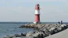 Red lighthouse of Warnemuende at Baltic Sea Stock Footage