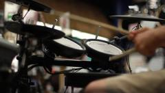 Person Playing Electronic Drums at Music Store Stock Footage