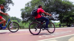 People do sport like biking, walking and running. Stock Footage