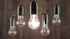 Incandescence bulbs on wood background Stock Footage