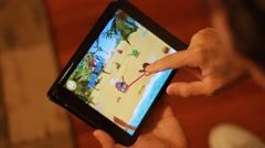 Person Playing Tablet Game - stock footage