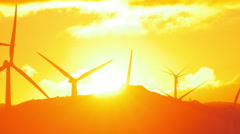 Silhouettes of wind mills turbines at sunset Stock Footage