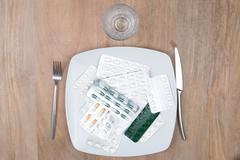 A Pills on a plate as food supplement Stock Photos