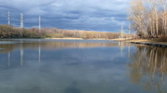 Lake in the city with reflection of clouds in the spring 4K UHD - stock footage