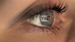 Woman girl eye macro looking monitor, surfing Internet video Youtube - stock footage