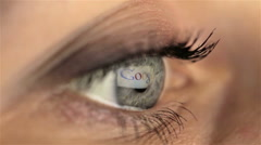 Woman girl macro eye looking monitor, searching Internet google - stock footage