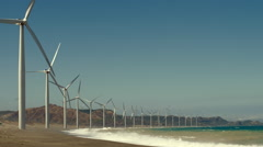 Wind farm on ocean shore Stock Footage