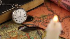 Antiquarian pocket watch and ancient world maps - stock footage