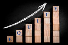 Word SUCCESS on ascending arrow above bar graph of Wooden small cubes - stock photo