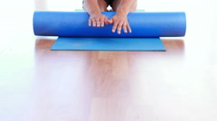Physiotherapy patient using foam roller Stock Footage