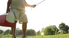 Man Holding Fishing Rod and Tackle Box Stock Footage
