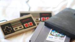 Pan Down Shot of Retro Video Games and Peripherals - stock footage