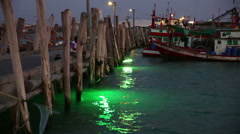 Green lights beam to sea surface at fishing pier, Thailand Stock Footage