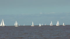Sailing Boats in a River on a Grey Day Stock Footage