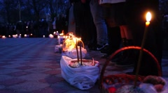 Easter cakes with burning candles before the consecration. Stock Footage