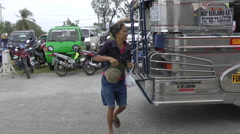 People walking of a jeepny at a market to buy food in Philippines Stock Footage