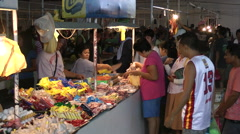 People doing shopping in a market before Typhoon hagupit hits Philippines Stock Footage