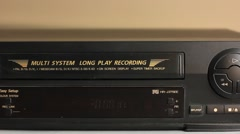 Inserting the video cassette into the VCR or VHS Stock Footage