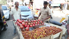 Local vendors selling pomegranate on a street of Mumbai. Stock Footage