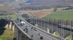Eurostar train passes traffic on the M2 Motorway Stock Footage