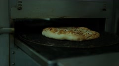 Pizza Coming Out Of Oven.mp4 Stock Footage