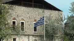 Greek flag waves in front of a building. Stock Footage