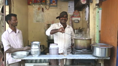Man making chai in tea shop on the streets of the capital. Stock Footage