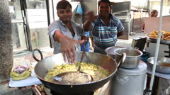 Local men preparing and selling food on the streets of Mumbai. Stock Footage