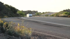 Telephoto Shot of a lone semi-truck passing Stock Footage