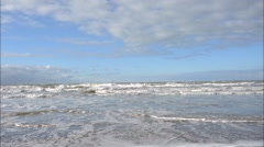 Waves lap the Dutch coast between Ijmuiden and Zandvoort Stock Footage