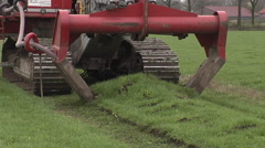 Laying drainage tube for water management Stock Footage