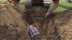 Laying drainage tubes in a meadow Stock Footage