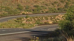 Semi-Trucks and cars on a scenic country road Stock Footage
