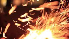 Sparks fire cracks in grill firepit - stock footage