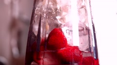 Making of a Banana, Strawberry, Mango fruit smoothie with Ice Stock Footage
