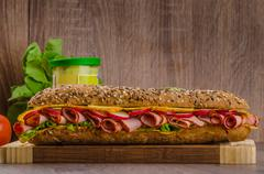 Wholemeal baguette with smoked rump Stock Photos