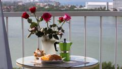 Delicious breakfast  with coffee and  fresh croissants  on balcony Stock Footage