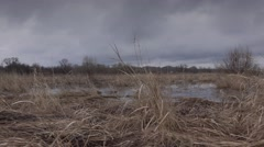 Flooded River in Prairie and Dramatic Sky Background.. 4K UltraHD, UHD Stock Footage