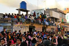 Onlookers are watching La Fiesta de la Mama Negra traditional festival - stock photo