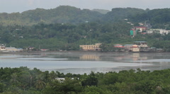 Aerial View of Coastal City Surrounded by Jungle - PALAU Stock Footage