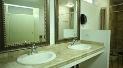 Clean Public Bathroom, Showers, and Sinks. Stock Footage