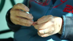 Trim Fingernails With a Nail Clipper Stock Footage