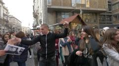 Man entertaining Justin Bieber's fans in Belgrade, Serbia Stock Footage