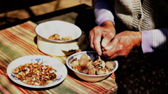 Unshelled and Peeling Walnuts - stock footage