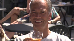 Man drinking traditional Belgian beer on hot day Stock Footage