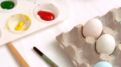 Happy mother and daughter painting easter eggs Stock Footage