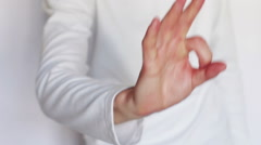 Man shows gestures and signs with his hands - stock footage