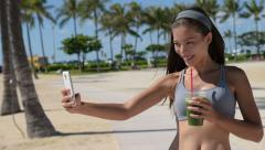 Fit Woman with Healthy Green Juice Taking Selfie Stock Footage