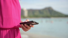 Woman in Fuchsia Dress Holding Mobile Phone Stock Footage